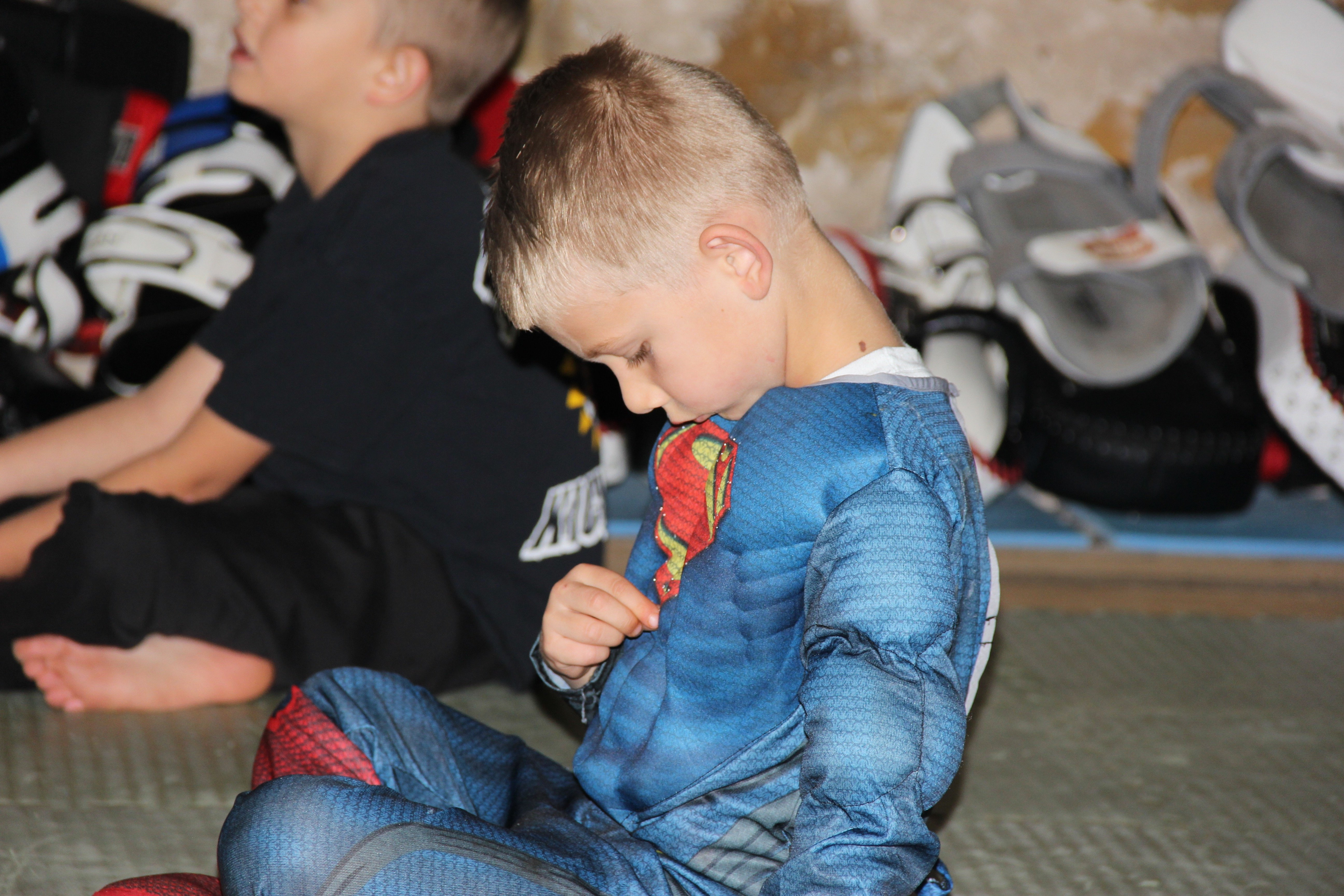 "Brownie says that he trains kids to have, ""strong minds and strong bodies."" This young student takes it seriously by sporting a superman suit to class."